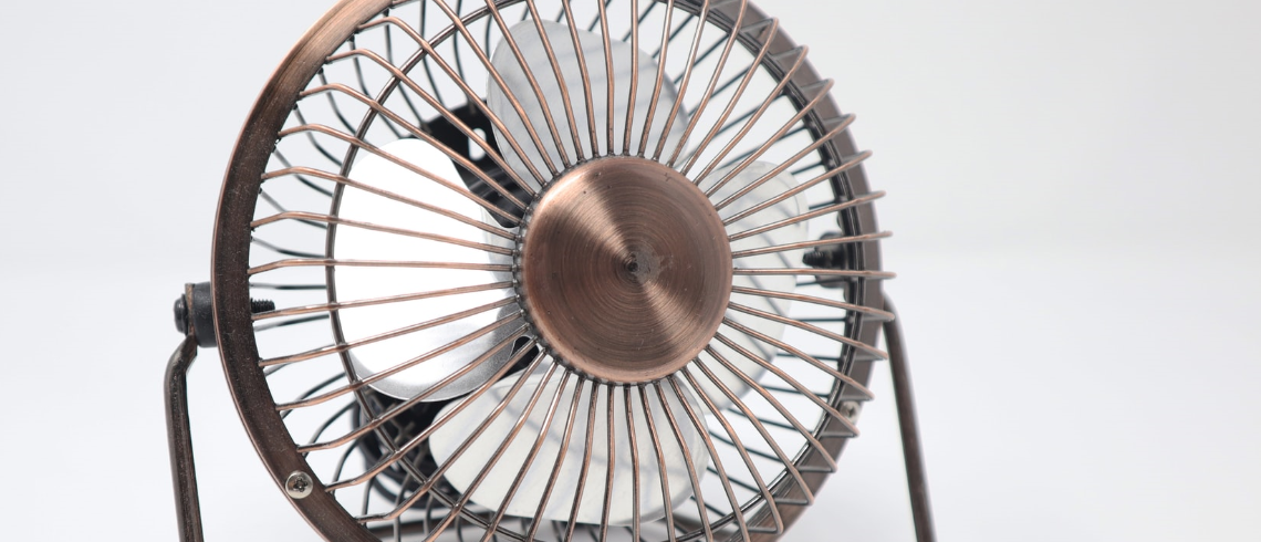 metal electric fan on a white background